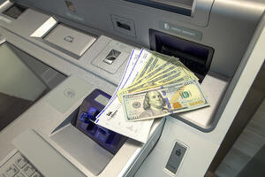 Withdrawing and depositing cash and checks on an advisor supported kiosk at first alliance credit union